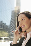 Businesswoman Using Mobile Phone Against Building Stock Images
