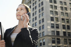 Businesswoman Using Mobile Phone Against Building Royalty Free Stock Photography