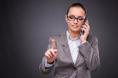 The businesswoman using mobile phone in business concept Stock Photo