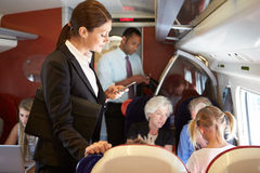 Businesswoman Using Mobile Phone On Busy Commuter Train stock images