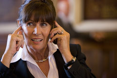 Businesswoman using mobile phone, close-up Royalty Free Stock Photography