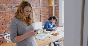 Businesswoman using mobile phone 4k stock video footage