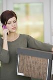 Businesswoman Using Mobile Phone With Moving Box Stock Image