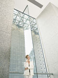 Businesswoman Using Mobile Phone In Office Building Royalty Free Stock Photo