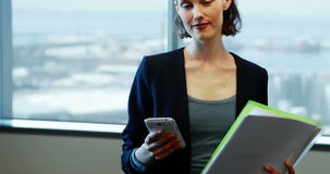 Businesswoman using mobile phone in office. Portrait of businesswoman using mobile phone in office stock video footage
