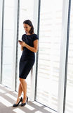 Businesswoman Using Mobile Phone In Office Royalty Free Stock Photos