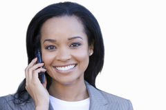Businesswoman using mobile phone, smiling, portrait, cut out Royalty Free Stock Photography
