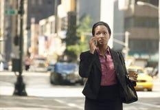 Businesswoman Using Mobile Phone On Street Stock Photo
