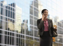 Businesswoman Using Mobile Phone On Street Royalty Free Stock Image