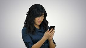 Businesswoman using of mobile phone on white background stock footage