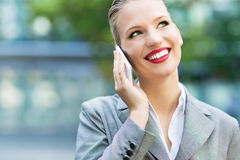Businesswoman using mobile phone Royalty Free Stock Photos