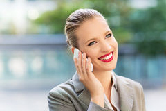 Businesswoman using mobile phone Stock Photos