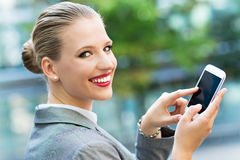 Businesswoman using mobile phone Stock Photography