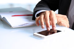 Businesswoman  using the mobile smart phone Stock Image