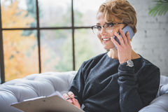 Businesswoman using mobile for talk Stock Image