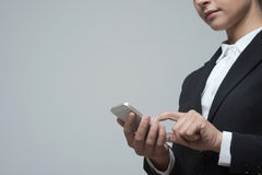 Businesswoman using mobile touch screen phone Stock Image