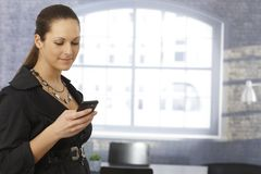 Businesswoman using mobile Stock Photography