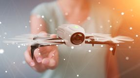 Businesswoman using modern drone 3D rendering. Businesswoman on blurred background using modern drone 3D rendering Stock Photography