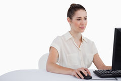 Businesswoman using a monitor Royalty Free Stock Images