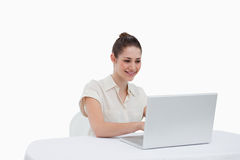 Businesswoman using a notebook Royalty Free Stock Photography
