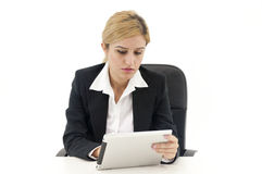 Businesswoman using pad. On a desk Stock Image