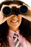 Businesswoman using a pair of binoculars Stock Image