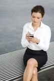 Businesswoman using palmtop. Young woman using palmtop, outdoors Stock Photo