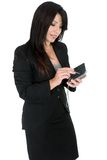 Businesswoman using a pda Stock Photo