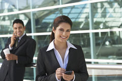 Businesswoman Using PDA Outside Office Royalty Free Stock Photography