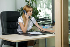 Businesswoman using phone Royalty Free Stock Image
