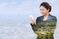 Businesswoman using phone with antenna of communication. Double exposure of businesswoman using phone with antenna of communication Royalty Free Stock Images