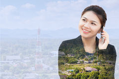Businesswoman using phone with antenna of communication. Double exposure of businesswoman using phone with antenna of communication Royalty Free Stock Photo