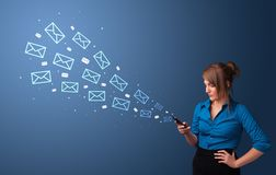 Businesswoman using phone with mail concept around royalty free stock photography
