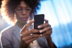 Businesswoman using a phone Stock Photo
