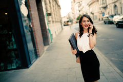 Businesswoman using phone outdoors Stock Photography