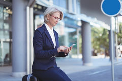 Businesswoman using phone Royalty Free Stock Images