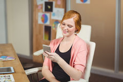 Businesswoman using phone Stock Images