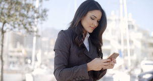 Businesswoman Using Phone On The Street Royalty Free Stock Photography