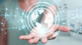 Businesswoman using planet earth network sphere 3D rendering Stock Photo