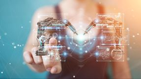 Businesswoman using robotics arms with digital screen 3D renderi. Businesswoman on blurred background using robotics arms with digital screen 3D rendering Stock Images