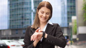 Businesswoman using smart watch in city downtown, professional female browsing chatting reading news stock footage