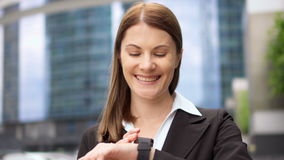 Businesswoman using smart watch in city downtown, professional female browsing chatting reading news stock video footage