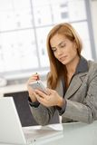 Businesswoman using smartphone Royalty Free Stock Images