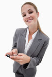 Businesswoman using a smartphone Royalty Free Stock Photo