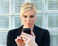 Businesswoman using smartphone Royalty Free Stock Photos