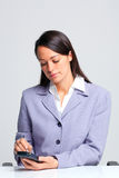 Businesswoman using a smartphone Royalty Free Stock Photos