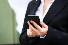 Businesswoman Using Smartphone Outdoors Stock Photo