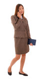 Businesswoman is using smartphone on white background. Royalty Free Stock Photo
