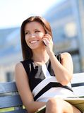 Businesswoman using a smartphone Royalty Free Stock Images
