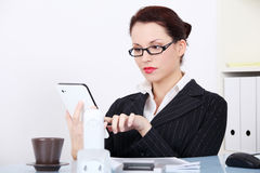 Businesswoman using a tablet. Royalty Free Stock Photography